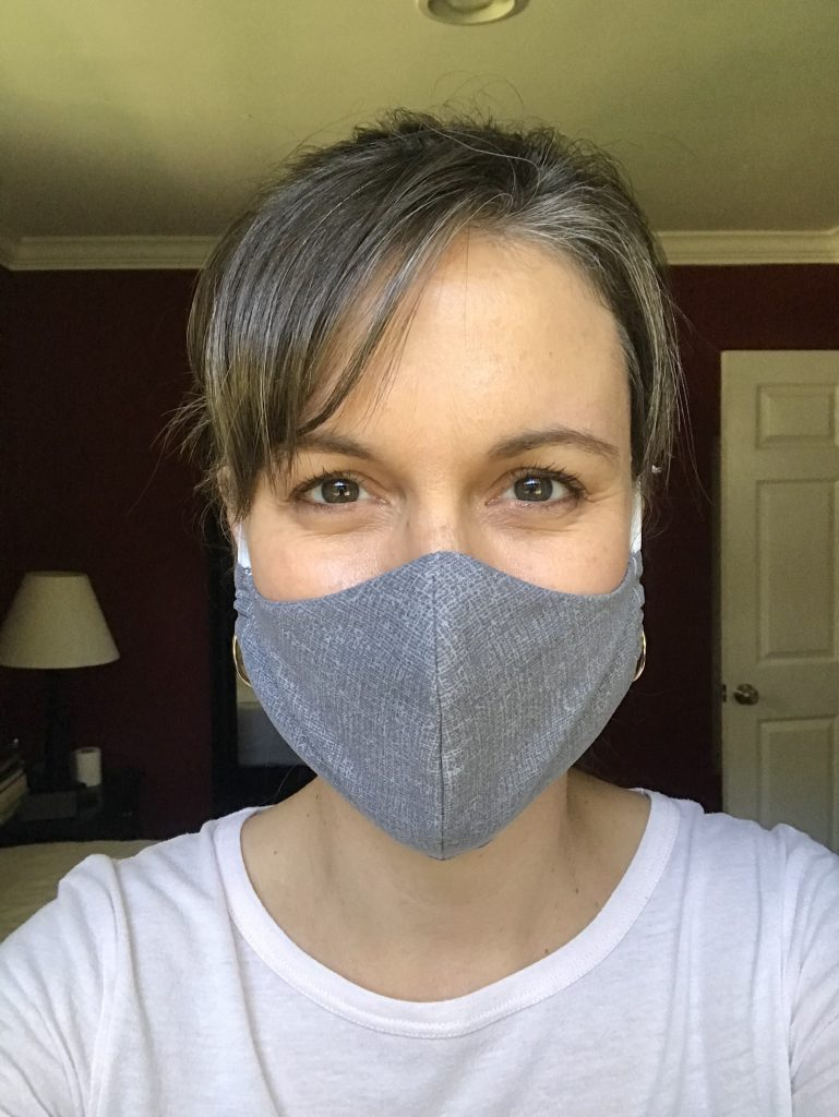 Kristen in a gray fabric mask