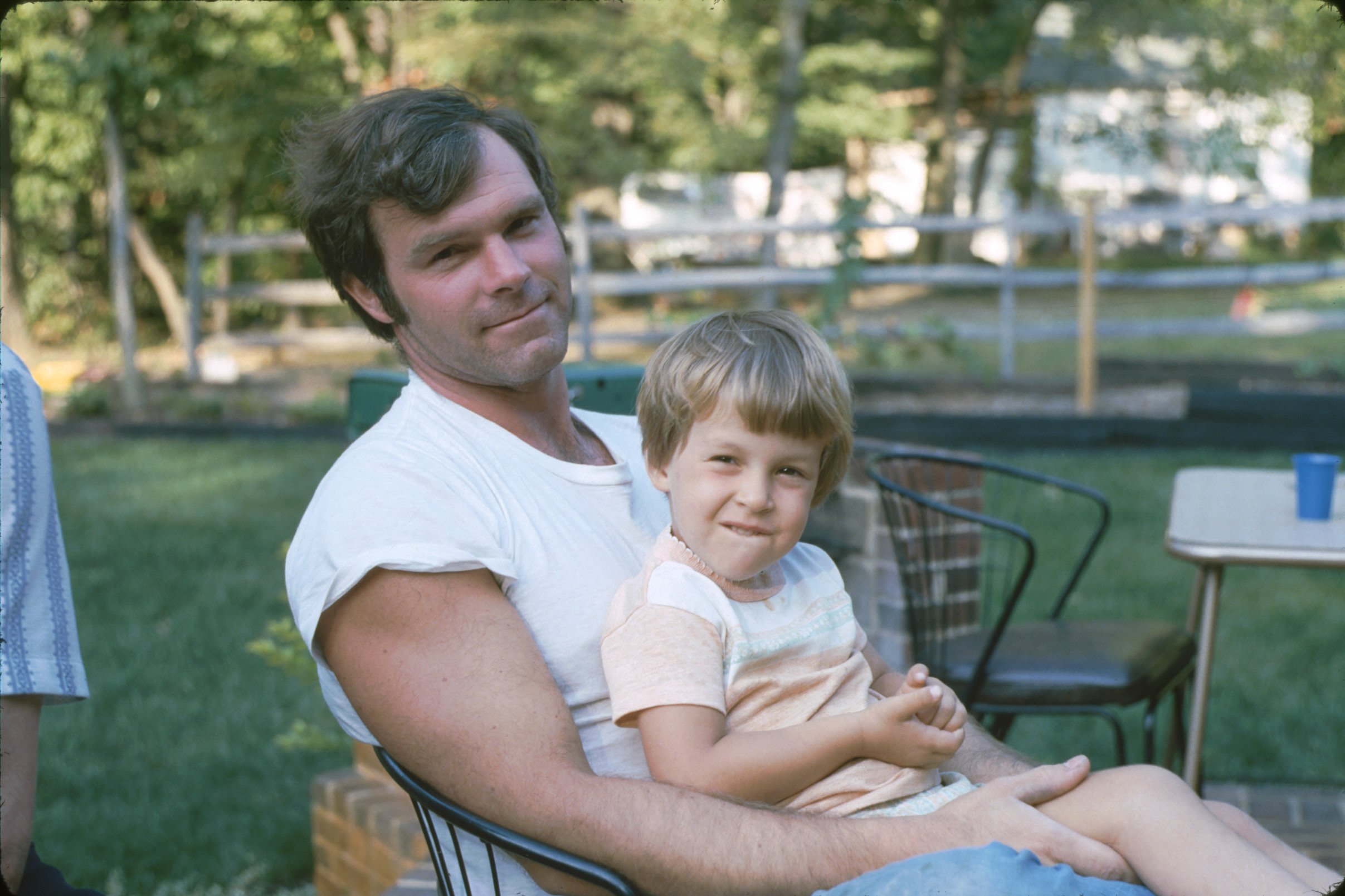 Kristen as a child, sitting in her uncle's lap.
