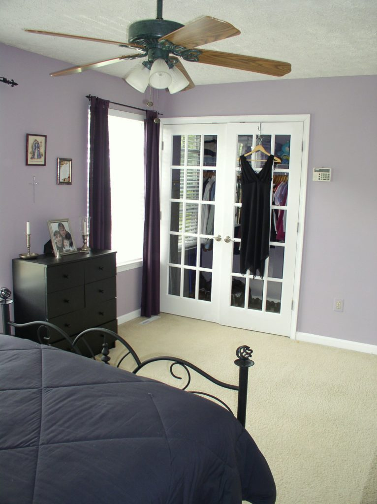 Purple bedroom with white French closet doors
