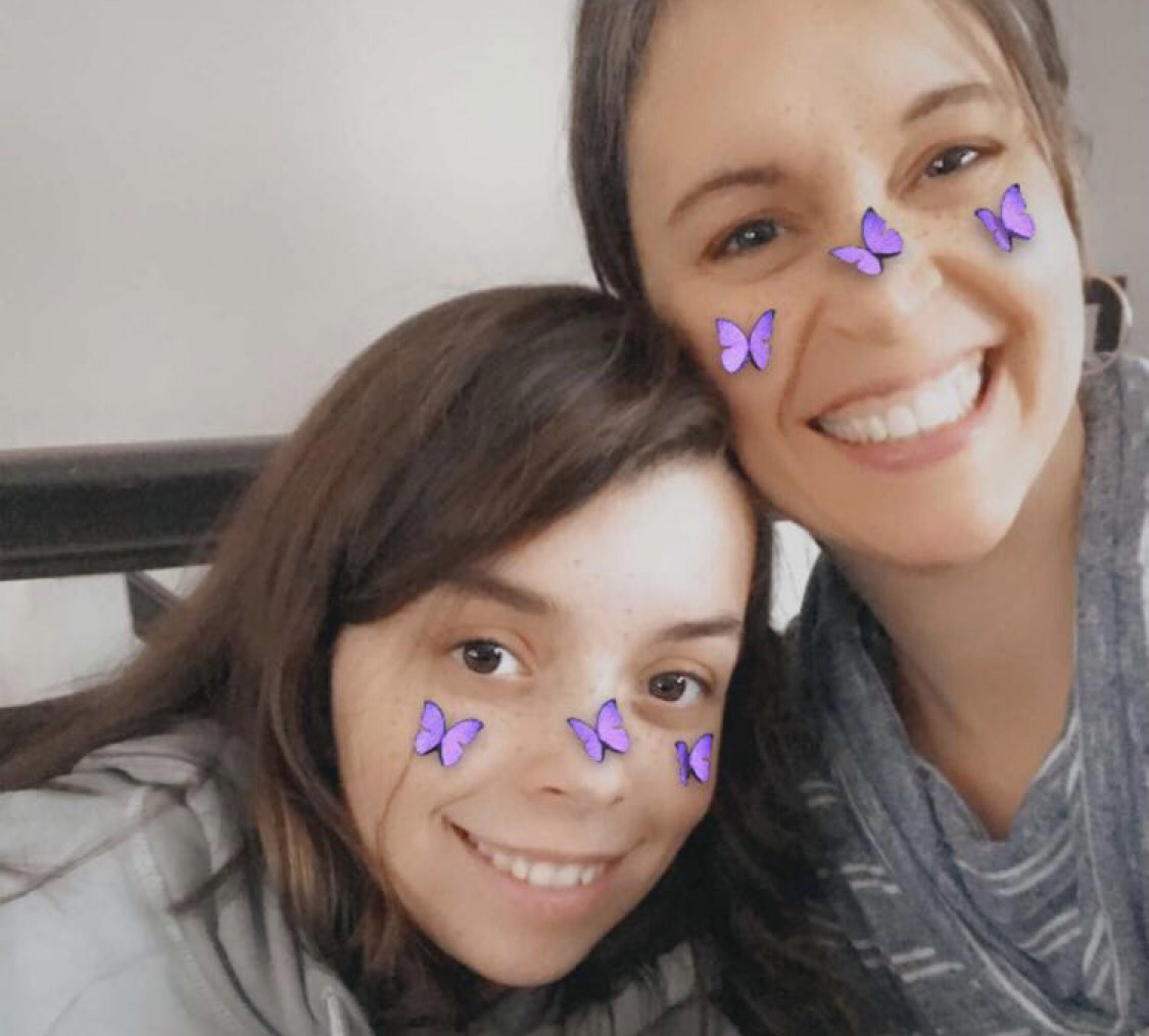 Kristen and Lisey with butterflies on their cheeks.